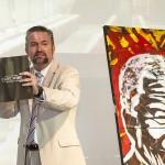 Auctioneer Paul Myson with John Adams' Nelson Mandela portrait
